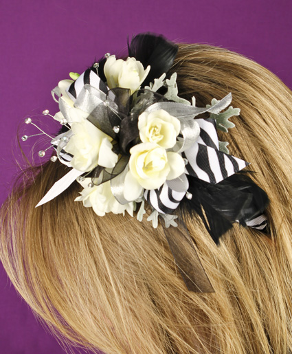 [Image: This fun black and white floral head band features white flowers with black and white printed ribbon and feathers. Such a fun added detail to any prom dress.]